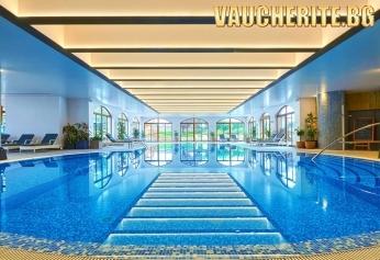 Нощувка със закуска + ползване на открит и закрит басейн, джакузи, фитнес и снежна стая от Kempinski Hotel Grand Arena Bansko